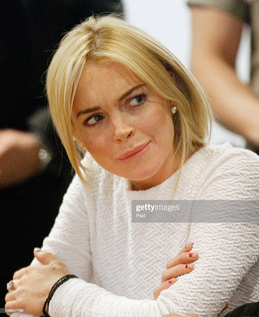 Actress <a gi-track='captionPersonalityLinkClicked' href=/galleries/search?phrase=Lindsay+Lohan&family=editorial&specificpeople=171623 ng-click='$event.stopPropagation()'>Lindsay Lohan</a> during her arraignment for a felony count of grand theft on February 9, 2011 in Los Angeles, California. Lohan was charged with a felony count of grand theft for allegedly stealing a $2,500 necklace from a jewelry store in Venice.