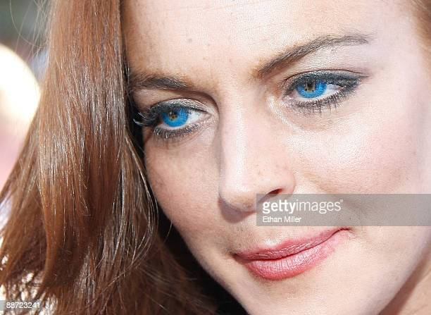 Actress Lindsay Lohan is interviewed as she arrives at the Wet Republic pool at the MGM Grand Hotel/Casino to celebrate her birthday and her Sevin...