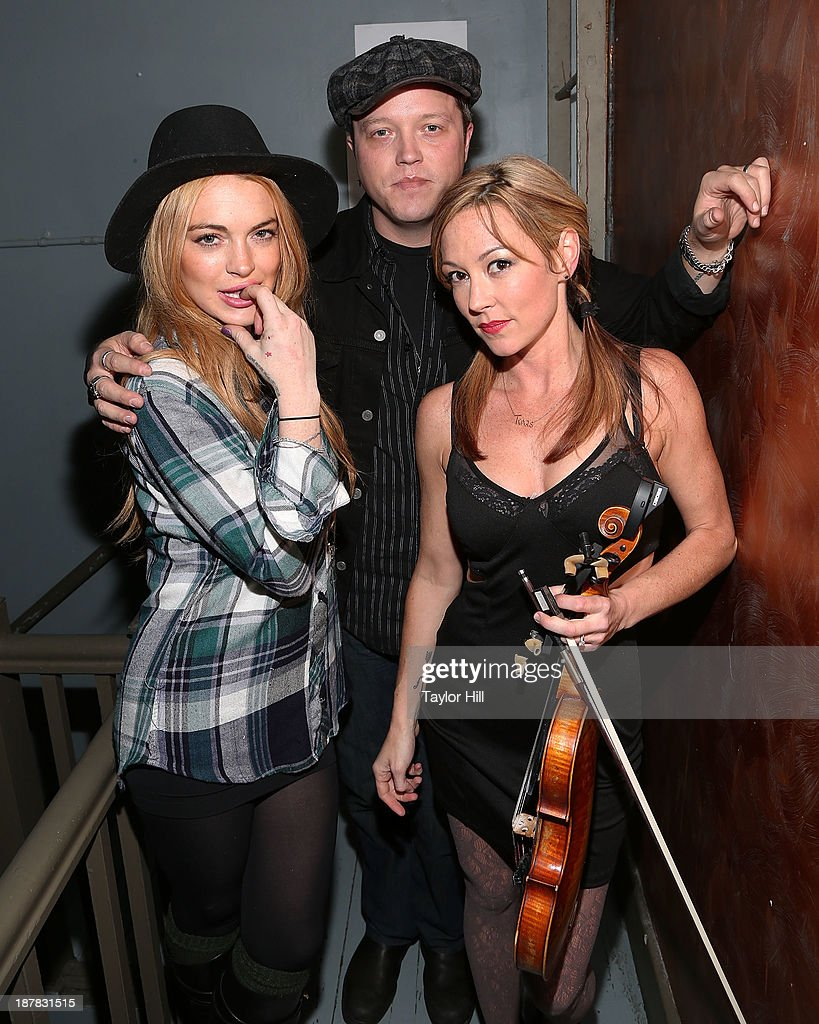 Actress Lindsay Lohan, musician Jason Isbell, and violinist Amanda Shires attend Dylan Fest NYC 2013>> at the Bowery Ballroom on November 12, 2013 in New York City.