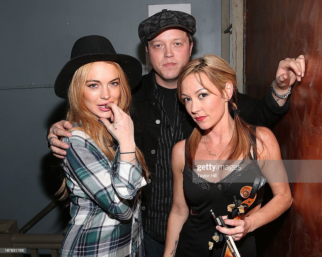 Actress Lindsay Lohan, musician Jason Isbell, and violinist Amanda Shires attend Dylan Fest NYC 2013 at the Bowery Ballroom on November 12, 2013 in New York City.
