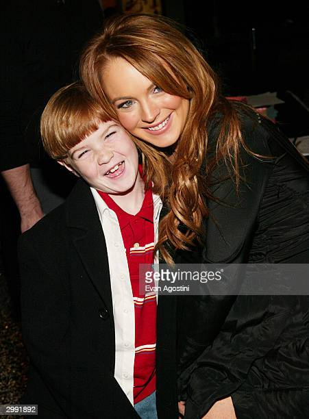 Actress Lindsay Lohan poses with her brother Dakota at the 'Confessions Of A Teenage Drama Queen' premiere at the Loews EWalk Theater February 17...