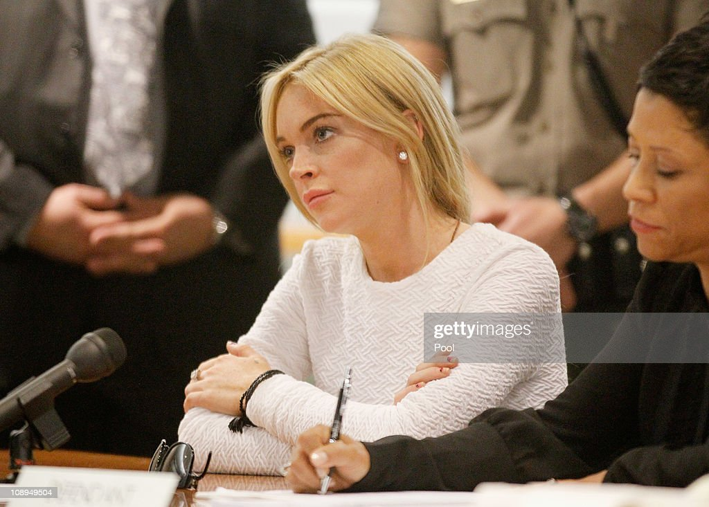Actress <a gi-track='captionPersonalityLinkClicked' href=/galleries/search?phrase=Lindsay+Lohan&family=editorial&specificpeople=171623 ng-click='$event.stopPropagation()'>Lindsay Lohan</a> (L) sits with her attorney <a gi-track='captionPersonalityLinkClicked' href=/galleries/search?phrase=Shawn+Chapman+Holley&family=editorial&specificpeople=5763122 ng-click='$event.stopPropagation()'>Shawn Chapman Holley</a> during her arraignment for a felony count of grand theft on February 9, 2011 in Los Angeles, California. Lohan was charged with a felony count of grand theft for allegedly stealing a $2,500 necklace from a jewelry store in Venice.