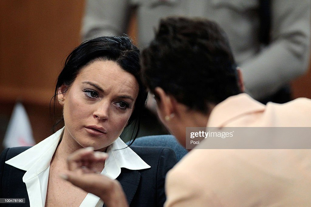 Actress Lindsay Lohan talks with her attorney Shawn Chapman Holley at the Beverly Hills Courthouse for a probation status hearing on May 24 2010 in...
