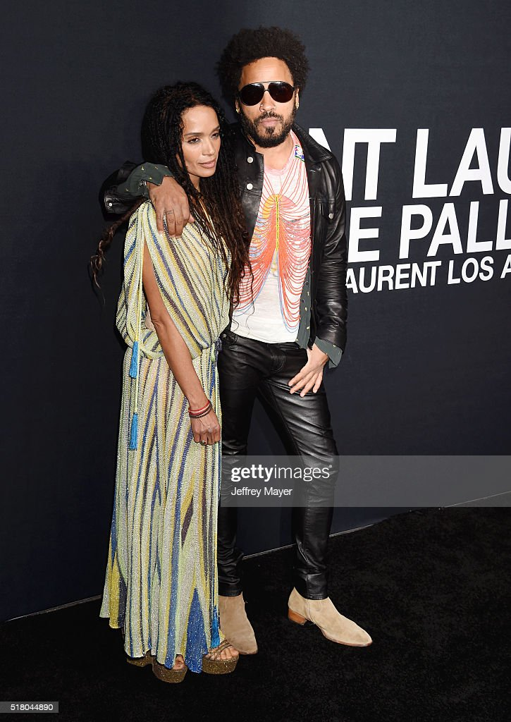 Actress Lisa Bonet (L) and musician Lenny Kravitz attend the Saint Laurent show at The Hollywood Palladium on February 10, 2016 in Los Angeles, California.