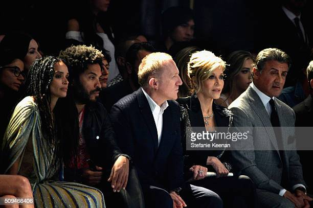 Actress Lisa Bonet recording artist Lenny Kravitz CEO of Kering FrancoisHenri Pinault and actors Jane Fonda in Saint Laurent by Hedi Slimane and...