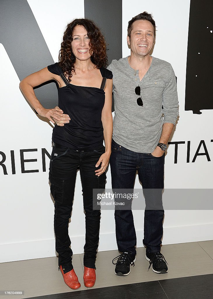 Actress Lisa Edelstein (L) and actor Seamus Dever attend the NKLA Pet Adoption Center Opening Celebration at the NKLA Pet Adoption Center on August 11, 2013 in Los Angeles, California.