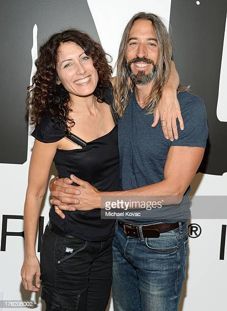 Actress Lisa Edelstein and artist Robert Russell attend the NKLA Pet Adoption Center Opening Celebration at the NKLA Pet Adoption Center on August 11...