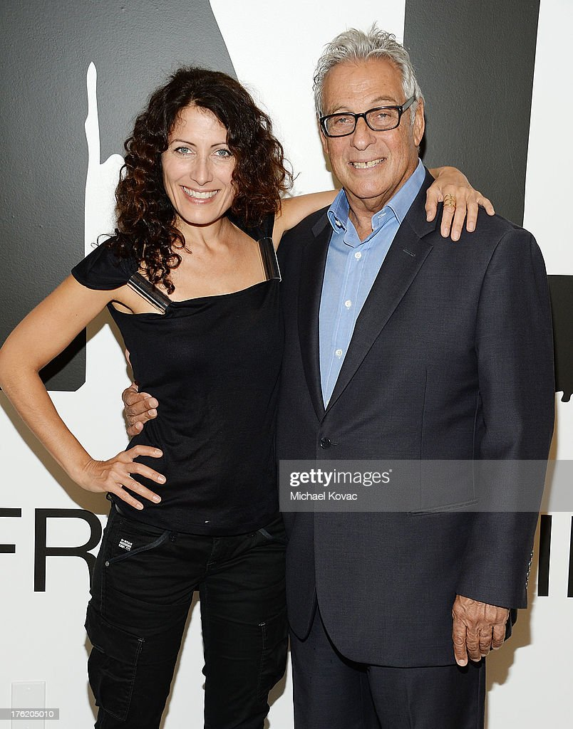 Actress <a gi-track='captionPersonalityLinkClicked' href=/galleries/search?phrase=Lisa+Edelstein&family=editorial&specificpeople=216555 ng-click='$event.stopPropagation()'>Lisa Edelstein</a> (L) and producer <a gi-track='captionPersonalityLinkClicked' href=/galleries/search?phrase=Hawk+Koch&family=editorial&specificpeople=627910 ng-click='$event.stopPropagation()'>Hawk Koch</a> attend the NKLA Pet Adoption Center Opening Celebration at the NKLA Pet Adoption Center on August 11, 2013 in Los Angeles, California.