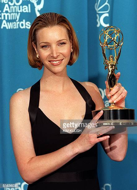 Actress Lisa Kudrow holds her Emmy award at the 50th Annual Primetime Emmy Awards 13 September at the Shrine Auditorium in Los Angeles CA Kudrow won...
