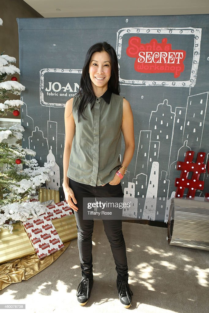 Actress Lisa Ling attends the 4th Annual Santa's Secret Workshop Benefiting LA Family Housing at Andaz Hotel on December 6 2014 in Los Angeles...