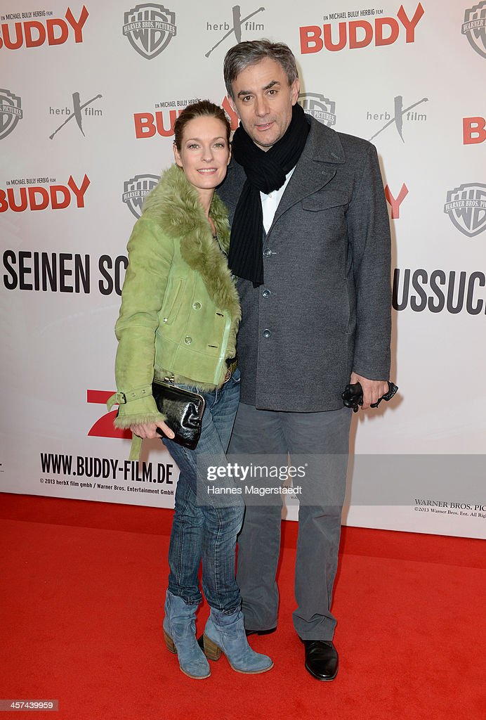 Actress <a gi-track='captionPersonalityLinkClicked' href=/galleries/search?phrase=Lisa+Martinek&family=editorial&specificpeople=228950 ng-click='$event.stopPropagation()'>Lisa Martinek</a> and her husband Giulio Ricciarelli attend 'Buddy' Premiere at Mathaeser Filmpalast on December 17, 2013 in Munich, Germany.