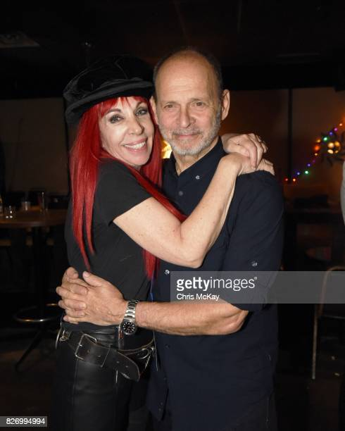 Actress Lisa Mende and Musician Wayne Kramer after the Artist2Artist Benefit For Homeless Veterans at The Office on August 5 2017 in Athens Georgia