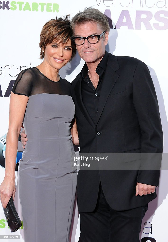 Actress <a gi-track='captionPersonalityLinkClicked' href=/galleries/search?phrase=Lisa+Rinna&family=editorial&specificpeople=202100 ng-click='$event.stopPropagation()'>Lisa Rinna</a> (L) and actor <a gi-track='captionPersonalityLinkClicked' href=/galleries/search?phrase=Harry+Hamlin&family=editorial&specificpeople=211584 ng-click='$event.stopPropagation()'>Harry Hamlin</a> arrive at the Los Angeles premiere 'Veronica Mars' on March 12, 2014 at TCL Chinese Theatre in Hollywood, California.