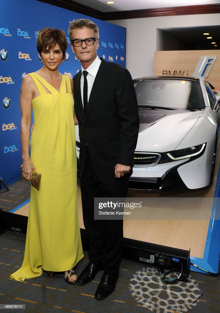 Actress <a gi-track='captionPersonalityLinkClicked' href=/galleries/search?phrase=Lisa+Rinna&family=editorial&specificpeople=202100 ng-click='$event.stopPropagation()'>Lisa Rinna</a> (L) and actor <a gi-track='captionPersonalityLinkClicked' href=/galleries/search?phrase=Harry+Hamlin&family=editorial&specificpeople=211584 ng-click='$event.stopPropagation()'>Harry Hamlin</a> attend the 66th Annual Directors Guild Of America Awards held at the Hyatt Regency Century Plaza on January 25, 2014 in Century City, California.