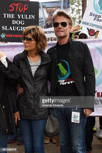 Actress Lisa Rinna and actor Harry Hamlin attend the StopYulinForever March to End Dog Cruelty in Yulin China at MaCarthur Park Recreation Center on...