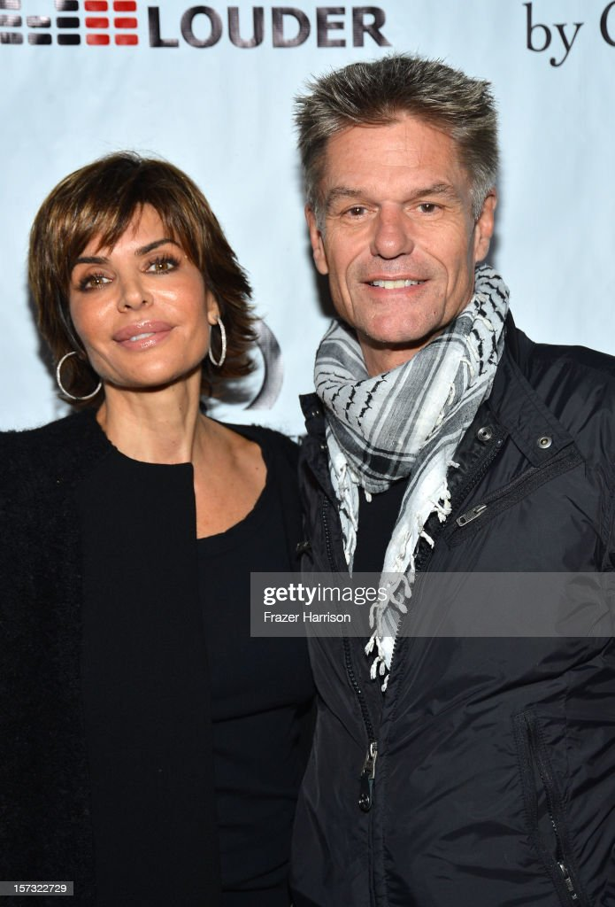 Actress Lisa Rinna and Harry Hamlin arrive at Chaz Dean's Holiday Party Benefitting the Love is Louder Movement on December 1, 2012 in Los Angeles, California.