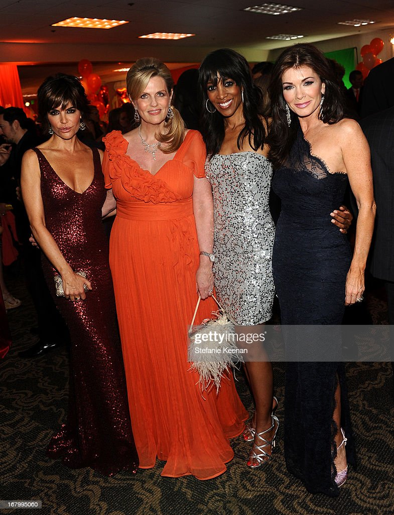Actress <a gi-track='captionPersonalityLinkClicked' href=/galleries/search?phrase=Lisa+Rinna&family=editorial&specificpeople=202100 ng-click='$event.stopPropagation()'>Lisa Rinna</a>, host <a gi-track='captionPersonalityLinkClicked' href=/galleries/search?phrase=Nancy+Davis+-+Philanthropist&family=editorial&specificpeople=216112 ng-click='$event.stopPropagation()'>Nancy Davis</a>, TV personality <a gi-track='captionPersonalityLinkClicked' href=/galleries/search?phrase=Shaun+Robinson&family=editorial&specificpeople=209263 ng-click='$event.stopPropagation()'>Shaun Robinson</a>, and TV personality <a gi-track='captionPersonalityLinkClicked' href=/galleries/search?phrase=Lisa+Vanderpump&family=editorial&specificpeople=6834933 ng-click='$event.stopPropagation()'>Lisa Vanderpump</a> attend the 20th Annual Race To Erase MS Gala 'Love To Erase MS' at the Hyatt Regency Century Plaza on May 3, 2013 in Century City, California.