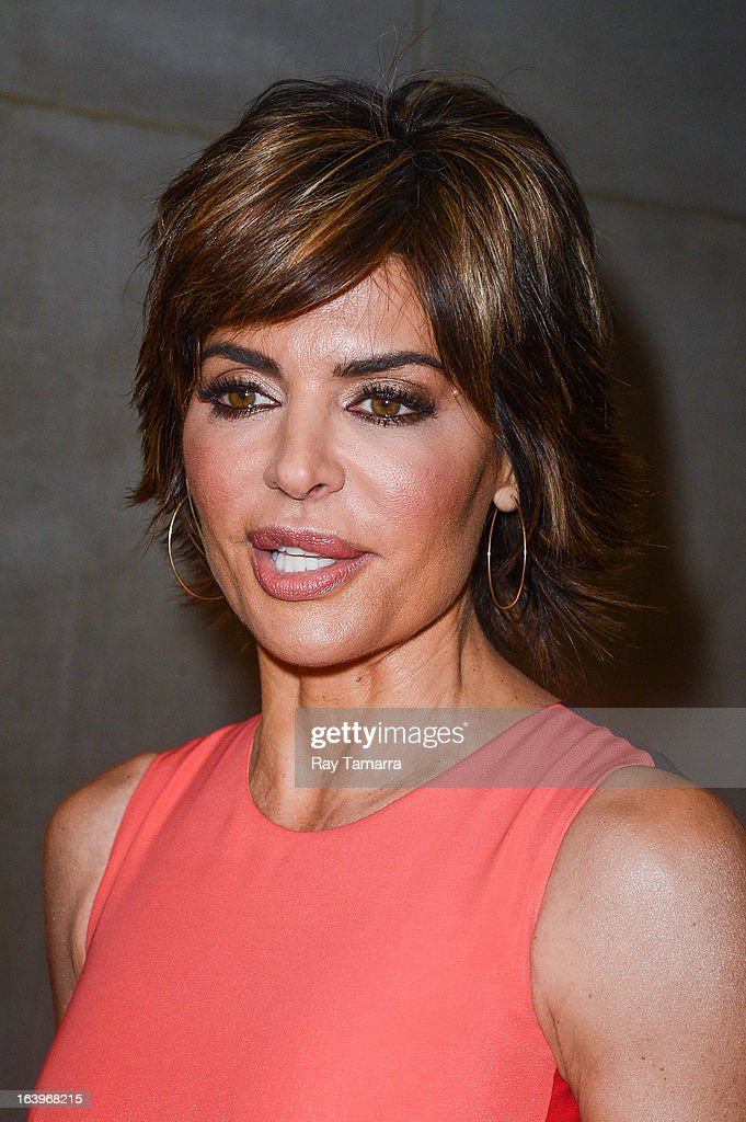 Actress <a gi-track='captionPersonalityLinkClicked' href=/galleries/search?phrase=Lisa+Rinna&family=editorial&specificpeople=202100 ng-click='$event.stopPropagation()'>Lisa Rinna</a> leaves the 'Today Show' taping at the NBC Rockefeller Center Studios on March 18, 2013 in New York City.