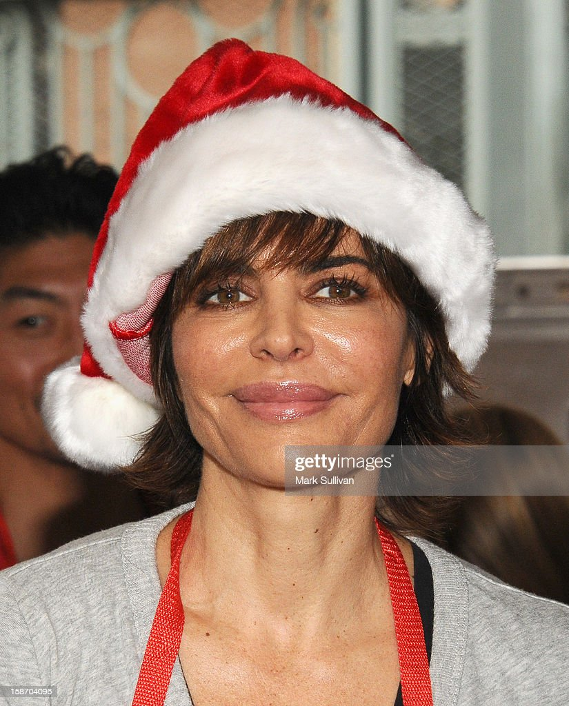 Actress Lisa Rinna serves food during the Los Angeles Mission Christmas Eve meal for the homeless at Los Angeles Mission on December 24, 2012 in Los Angeles, California.