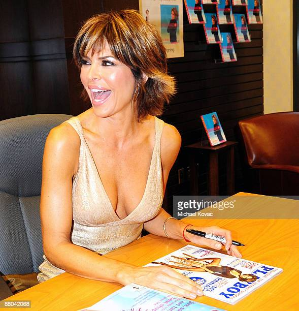 Actress Lisa Rinna Signs a copy of her Playboy magazine cover at the book signing of her new book 'Rinnavation' at Barnes Noble Bookstore at The...
