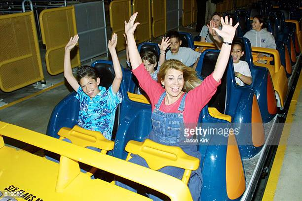 Actress Lisa Whelchel and her son get ready to ride Goliath a roller coaster at Six Flags Magic Mountain March 29 2001 in Valencia CA
