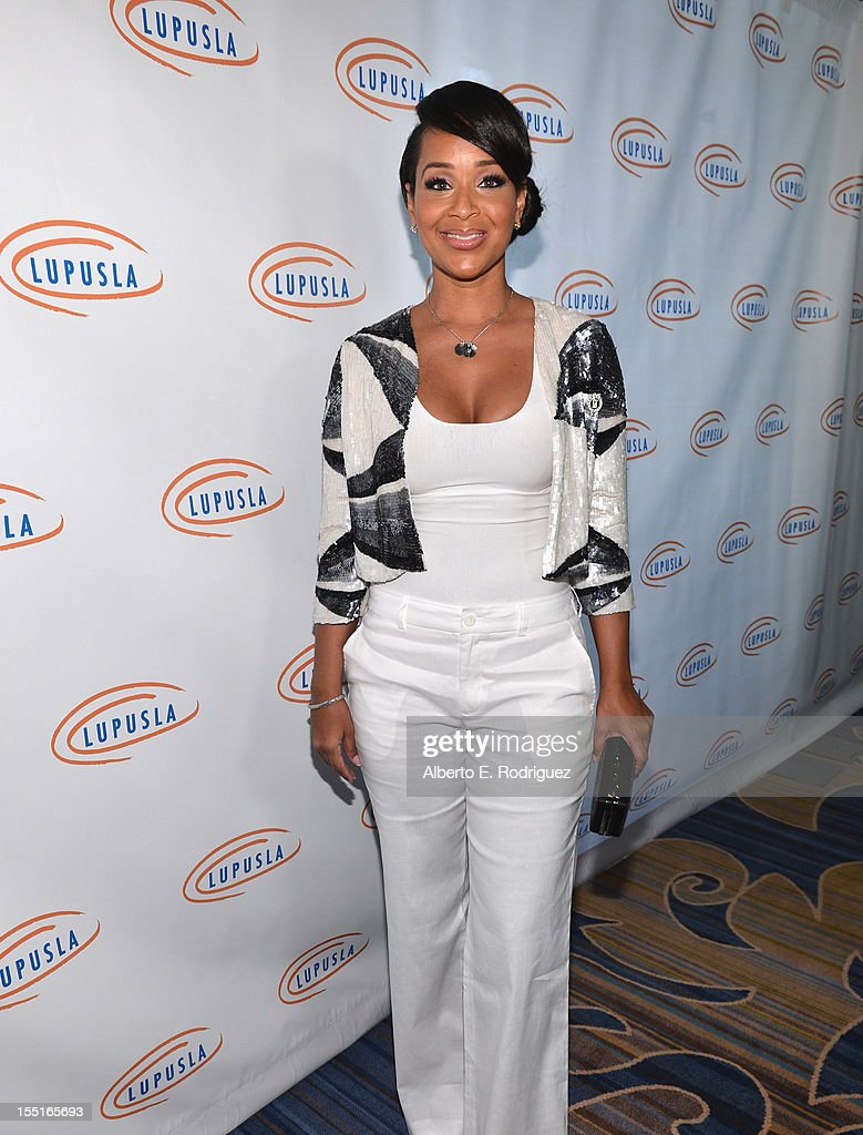 Actress LisaRaye McCoy arrives to the Lupus LA 10th Anniversary Hollywood Bag Ladies Luncheon at Regent Beverly Wilshire Hotel on November 1, 2012 in Beverly Hills, California.
