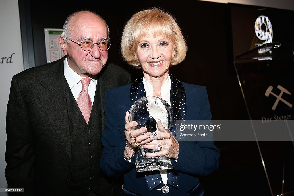 Actress Liselotte Pulver poses with her award as laudatio <a gi-track='captionPersonalityLinkClicked' href=/galleries/search?phrase=Alfred+Biolek&family=editorial&specificpeople=857297 ng-click='$event.stopPropagation()'>Alfred Biolek</a> smiles during the Steiger Award 2013 at Dortmunder U on October 12, 2013 in Dortmund, Germany. Pulver received the lifetime achievement award.