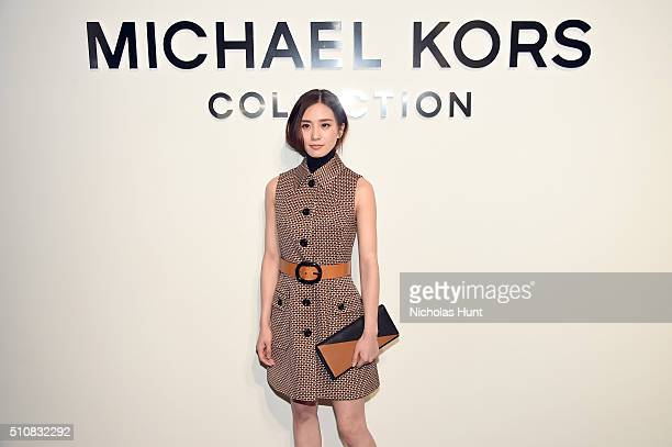 Actress Liu Shishi poses backstage at the Michael Kors Fall 2016 Runway Show during New York Fashion Week The Shows at Spring Studios on February 17...
