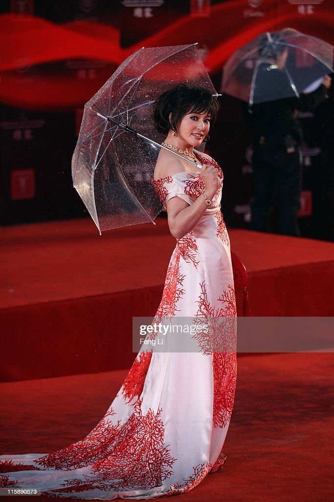 Actress Liu Xiaoqing arrives at the opening ceremony of the 14th Shanghai International Film Festival on June 11, 2011 in Shanghai, China.
