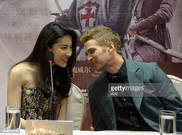 Actress Liu Yifei and actor Hayden Christensen attend Nick Powell's new movie 'Out Cast' press conference on September 23 2014 in Guangzhou China