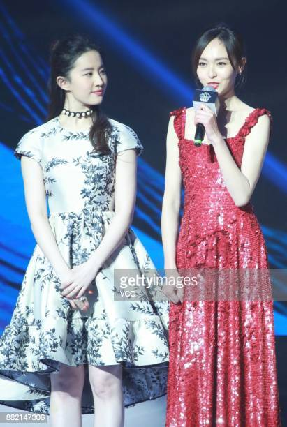 Actress Liu Yifei and actress Tiffany Tang arrive at the red carpet of L'Officiel Fashion Night 2017 on November 29 2017 in Beijing China