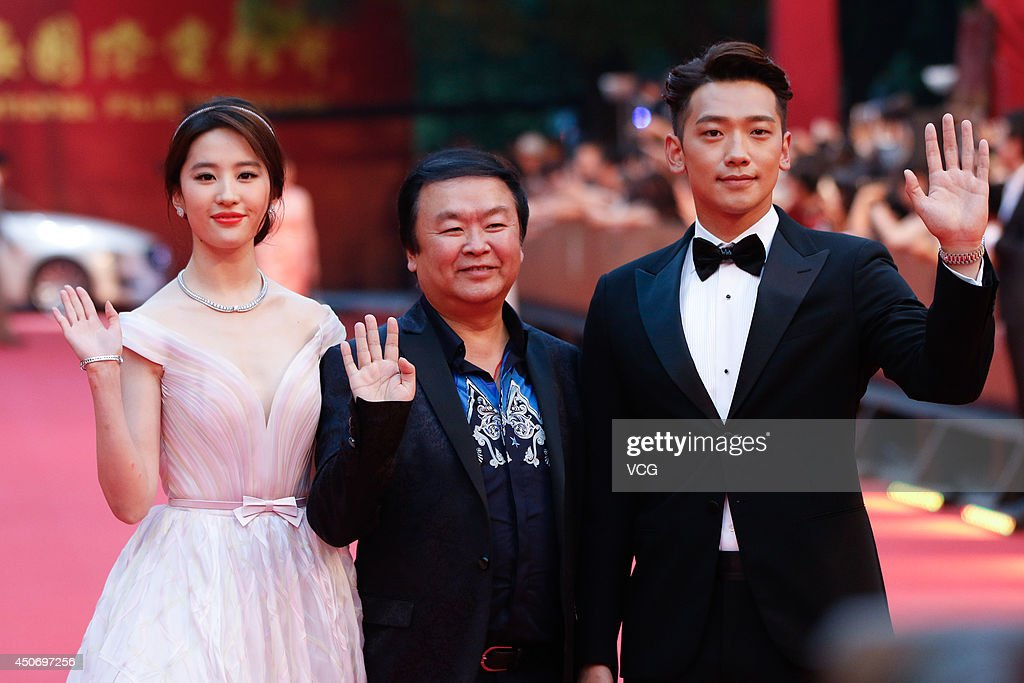 Actress <a gi-track='captionPersonalityLinkClicked' href=/galleries/search?phrase=Liu+Yifei&family=editorial&specificpeople=2229377 ng-click='$event.stopPropagation()'>Liu Yifei</a>, director Gao Xixi and South Korea singer/actor Rain walk the red carpet at the 17th Shanghai International Film Festival (SIFF) on June 14, 2014 in Shanghai, China.