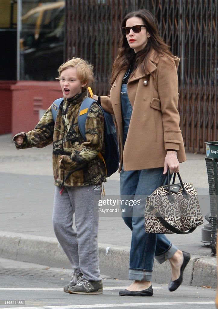 Actress <a gi-track='captionPersonalityLinkClicked' href=/galleries/search?phrase=Liv+Tyler&family=editorial&specificpeople=202094 ng-click='$event.stopPropagation()'>Liv Tyler</a> and Milo William Langdon are seen Walking in Soho on October 29, 2013 in New York City.