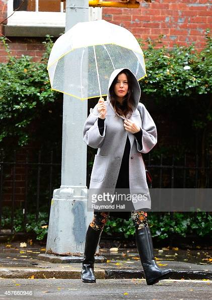 Actress Liv Tyler is seen walking in the rain in Soho on October 22 2014 in New York City