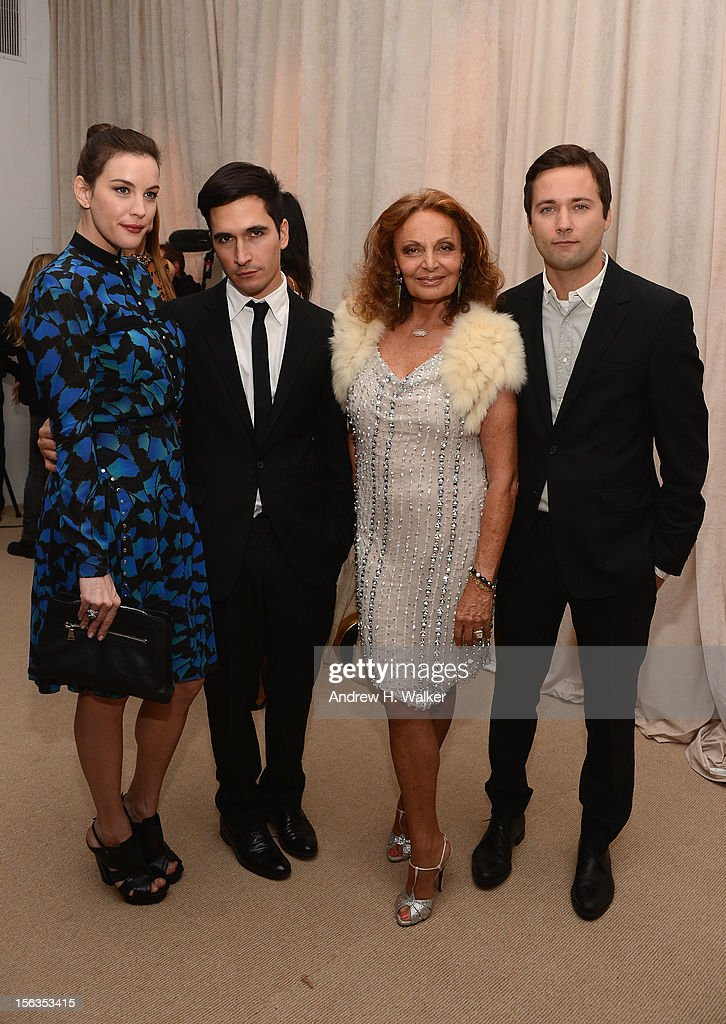Actress Liv Tyler, Lazaro Hernandez, Diane von Furstenberg and Jack McCollough attend The Ninth Annual CFDA/Vogue Fashion Fund Awards at 548 West 22nd Street on November 13, 2012 in New York City.
