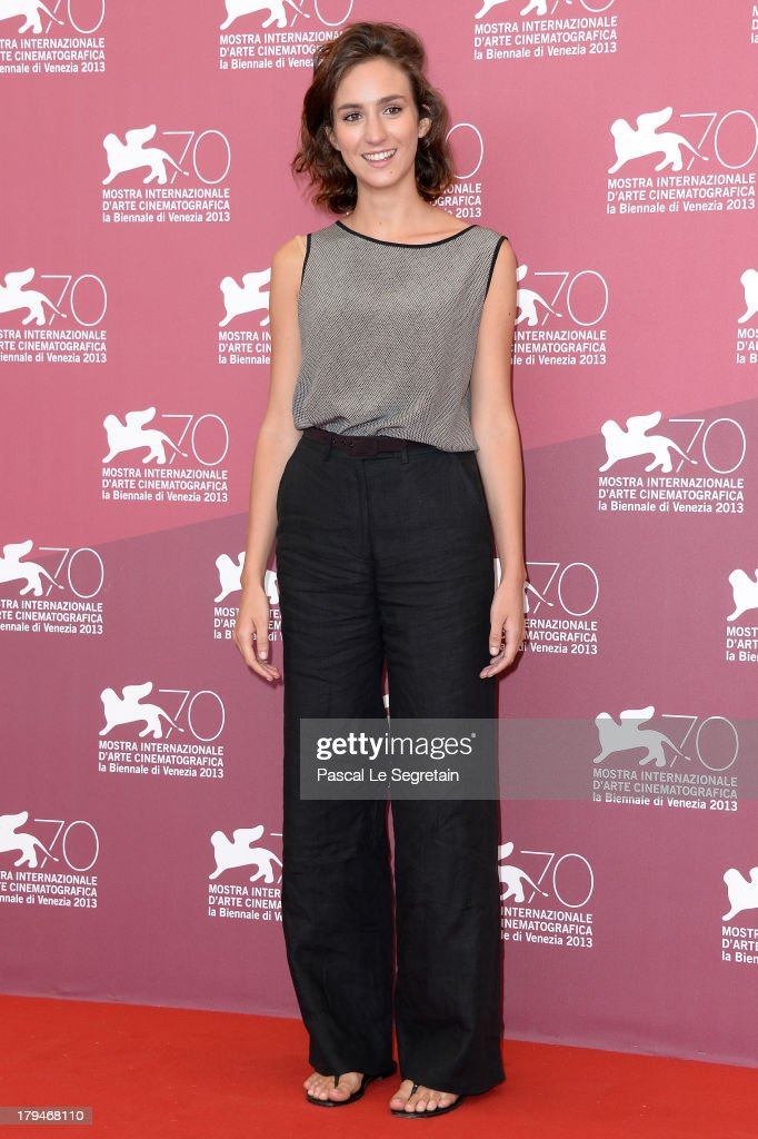 Actress <a gi-track='captionPersonalityLinkClicked' href=/galleries/search?phrase=Livia+Rossi&family=editorial&specificpeople=11330408 ng-click='$event.stopPropagation()'>Livia Rossi</a> attends 'L'Intrepido' Photocall during the 70th Venice International Film Festival at Palazzo del Casino on September 4, 2013 in Venice, Italy.