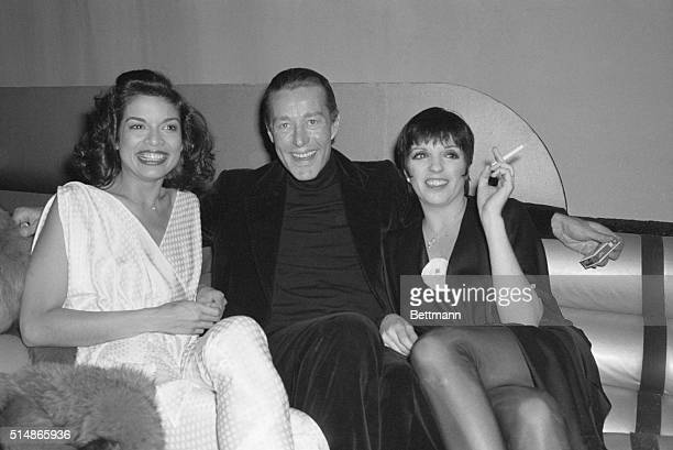 Actress Liza Minnelli currently on Broadway in musical entitled 'The Act' at the Majestic Theatre relaxes at Studio 54 with fashion designer Halston...