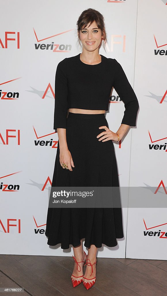 Actress <a gi-track='captionPersonalityLinkClicked' href=/galleries/search?phrase=Lizzy+Caplan&family=editorial&specificpeople=599560 ng-click='$event.stopPropagation()'>Lizzy Caplan</a> arrives at the 14th Annual AFI Awards at Four Seasons Hotel Los Angeles at Beverly Hills on January 10, 2014 in Beverly Hills, California.