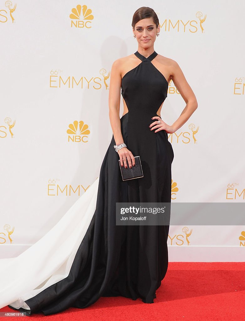 Actress <a gi-track='captionPersonalityLinkClicked' href=/galleries/search?phrase=Lizzy+Caplan&family=editorial&specificpeople=599560 ng-click='$event.stopPropagation()'>Lizzy Caplan</a> arrives at the 66th Annual Primetime Emmy Awards at Nokia Theatre L.A. Live on August 25, 2014 in Los Angeles, California.