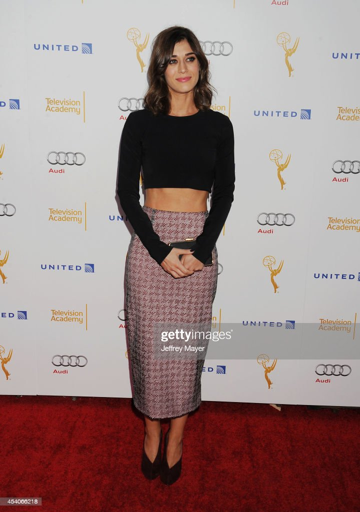 Actress Lizzy Caplan arrives at the Television Academy's 66th Emmy Awards Performance Nominee Reception at the Pacific Design Center on Saturday, Aug. 23, 2014, in West Hollywood, California.