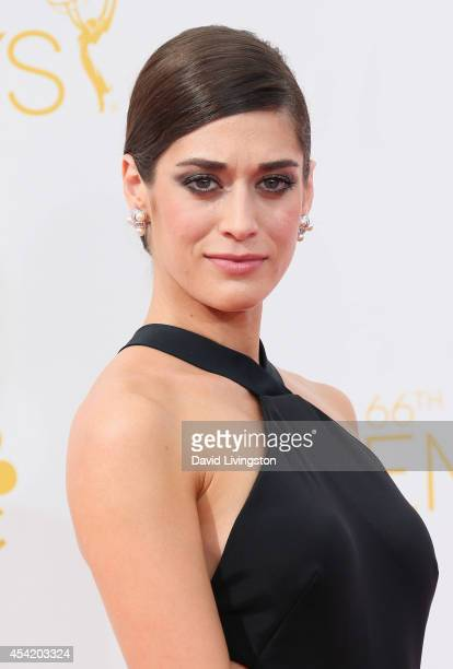 Actress Lizzy Caplan attends the 66th Annual Primetime Emmy Awards at the Nokia Theatre LA Live on August 25 2014 in Los Angeles California