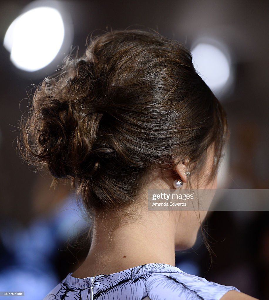 Actress Lizzy Caplan hair detail arrives at the premiere of Columbia Pictures' 'The Night Before' at The Theatre at The Ace Hotel on November 18 2015...