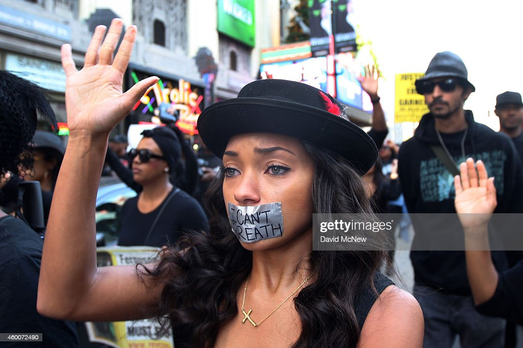 People march on Hollywood Boulevard in protest of the decision in New York not to indict a police officer involved in the chokehold death of Eric...
