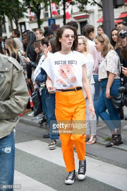 Actress Lola Viande wears a Monsta TShirt and trousers Converse trainers and Vintage sunglasses day 2 of Paris Haute Couture Fashion Week...