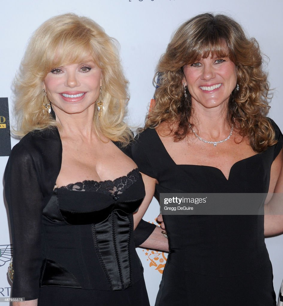 Actress Loni Anderson and daughter Deidra Hoffman arrive at the 21st Annual Race To Erase MS Gala at the Hyatt Regency Century Plaza on May 2, 2014 in Century City, California.
