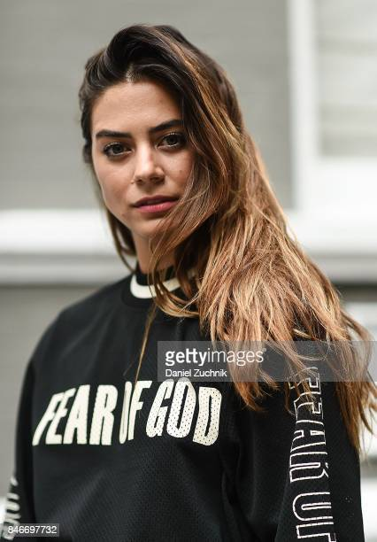 Actress Lorenza Izzo is seen wearing a Fear of God top during New York Fashion Week Women's S/S 2018 on September 13 2017 in New York City