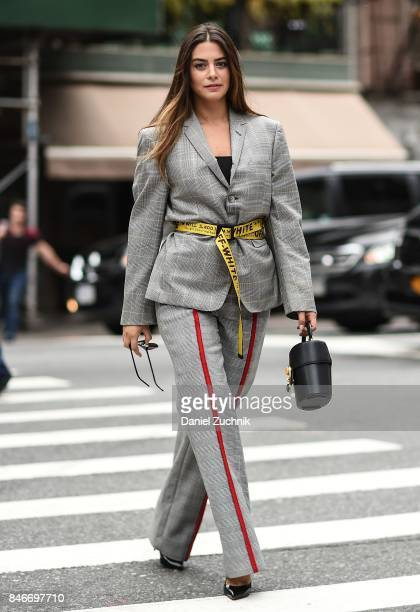 Actress Lorenza Izzo is seen wearing a Thom Browne blazer Annakiki pants Off White belt and Gentle Monster sunglasses during New York Fashion Week...