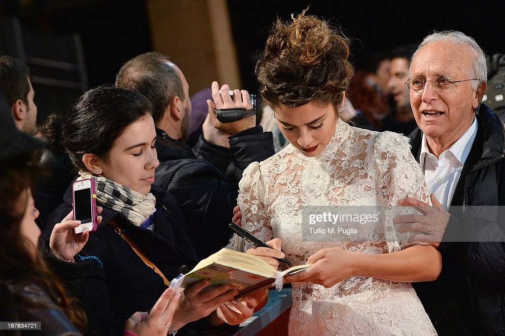 Actress Lorenza Izzo signs autographs as she attends 'The Green Inferno' Premiere during The 8th Rome Film Festival at Auditorium Parco Della Musica on November 12, 2013 in Rome, Italy.