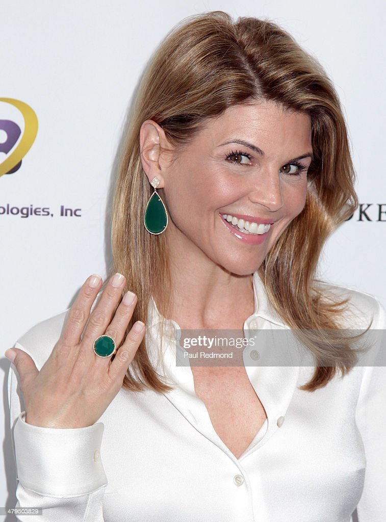 Actress Lori Laughlin with matching ring and earrings arriving at the 2nd Annual Norma Jean Gala 2014 at The Paley Center for Media on March 18, 2014 in Beverly Hills, California.