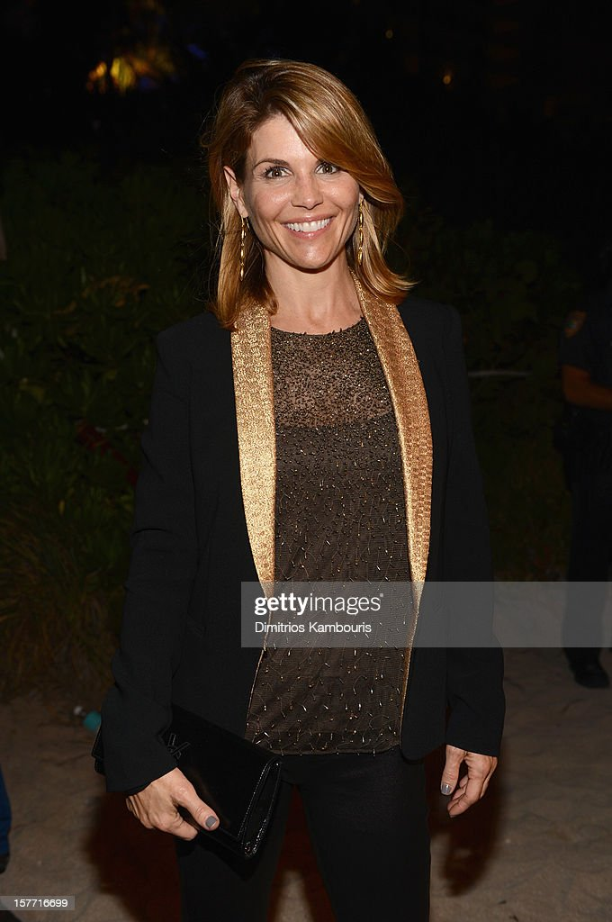 Actress <a gi-track='captionPersonalityLinkClicked' href=/galleries/search?phrase=Lori+Loughlin&family=editorial&specificpeople=208147 ng-click='$event.stopPropagation()'>Lori Loughlin</a> attends a Beachside Barbecue presented by CHANEL hosted by Art.sy Founder Carter Cleveland, Larry Gagosian, Wendi Murdoch, Peter Thiel and Dasha Zhukova at Soho Beach House on December 5, 2012 in Miami Beach, Florida.